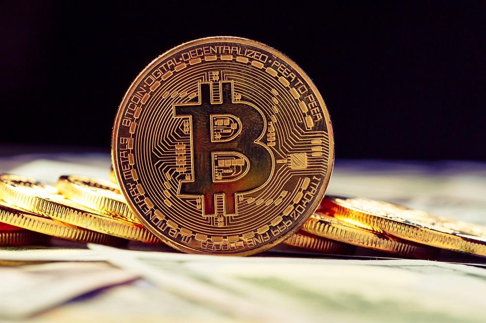 bigstock-Golden-Bitcoins-new-virtual-195710668.