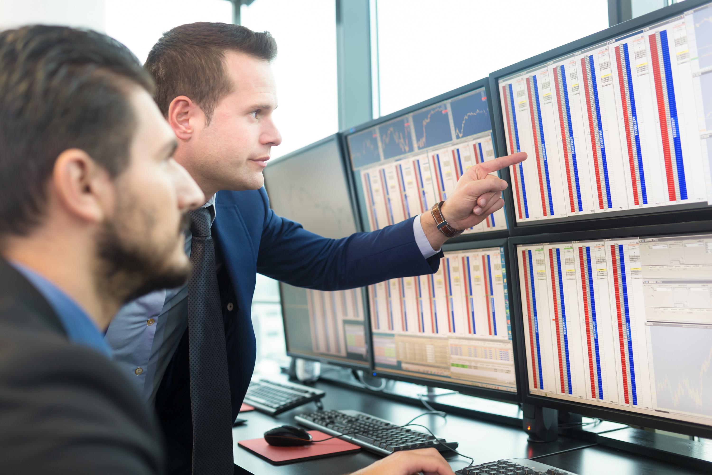 stock-traders-looking-at-screens-2.
