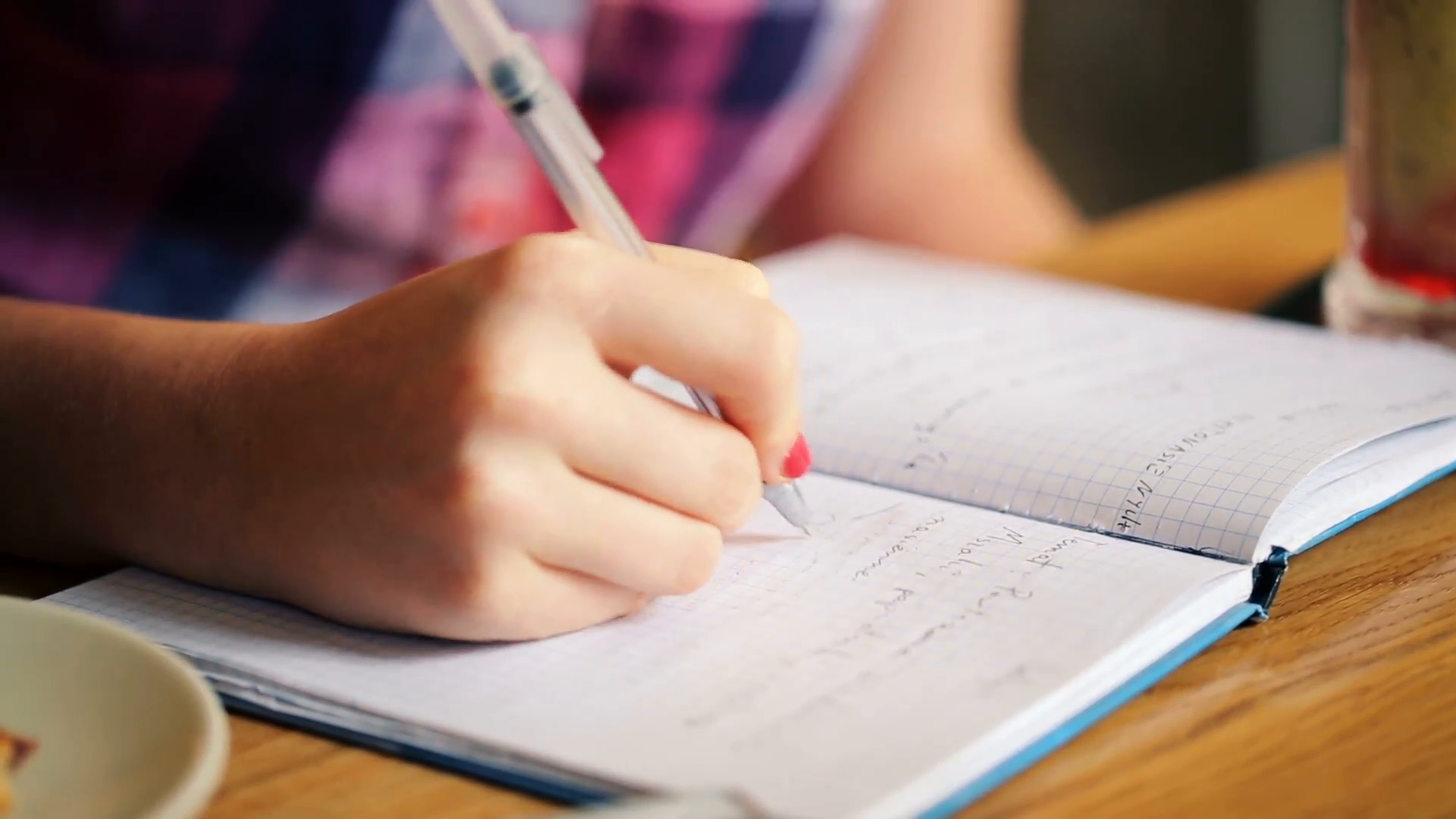 teenage-girl-hands-writing-in-notebook-doing-homework_vyfyytly__F0000.